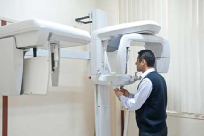 Man demonstrating the use of a dental x-ray radiograph