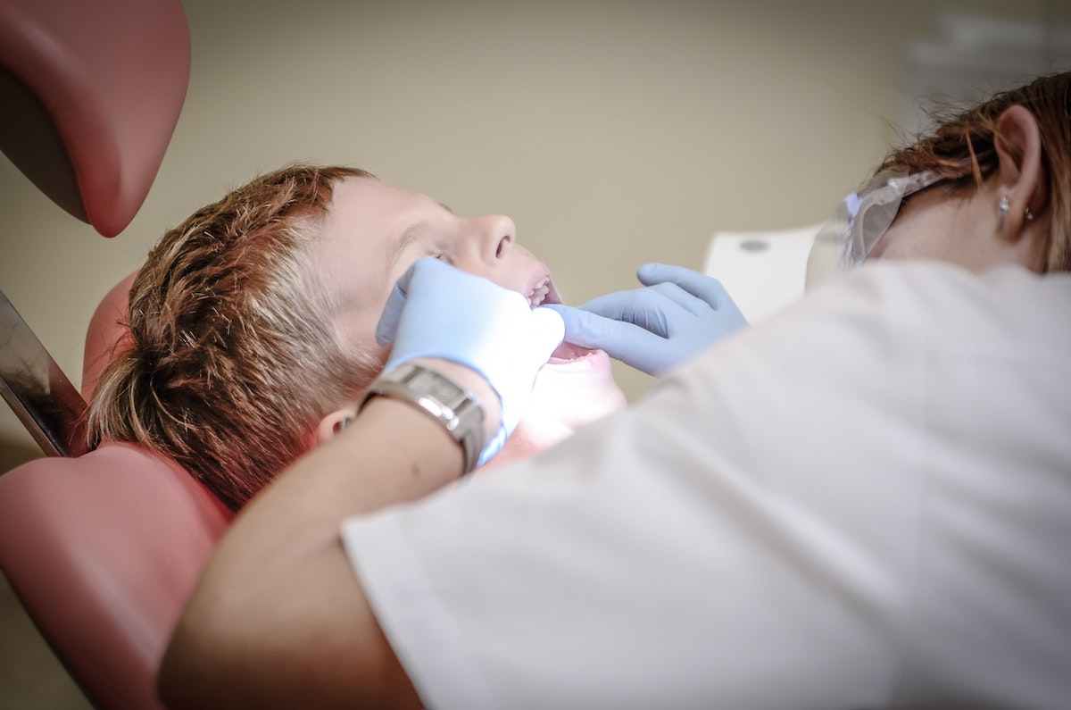 Young child getting sealants put on his baby teeth