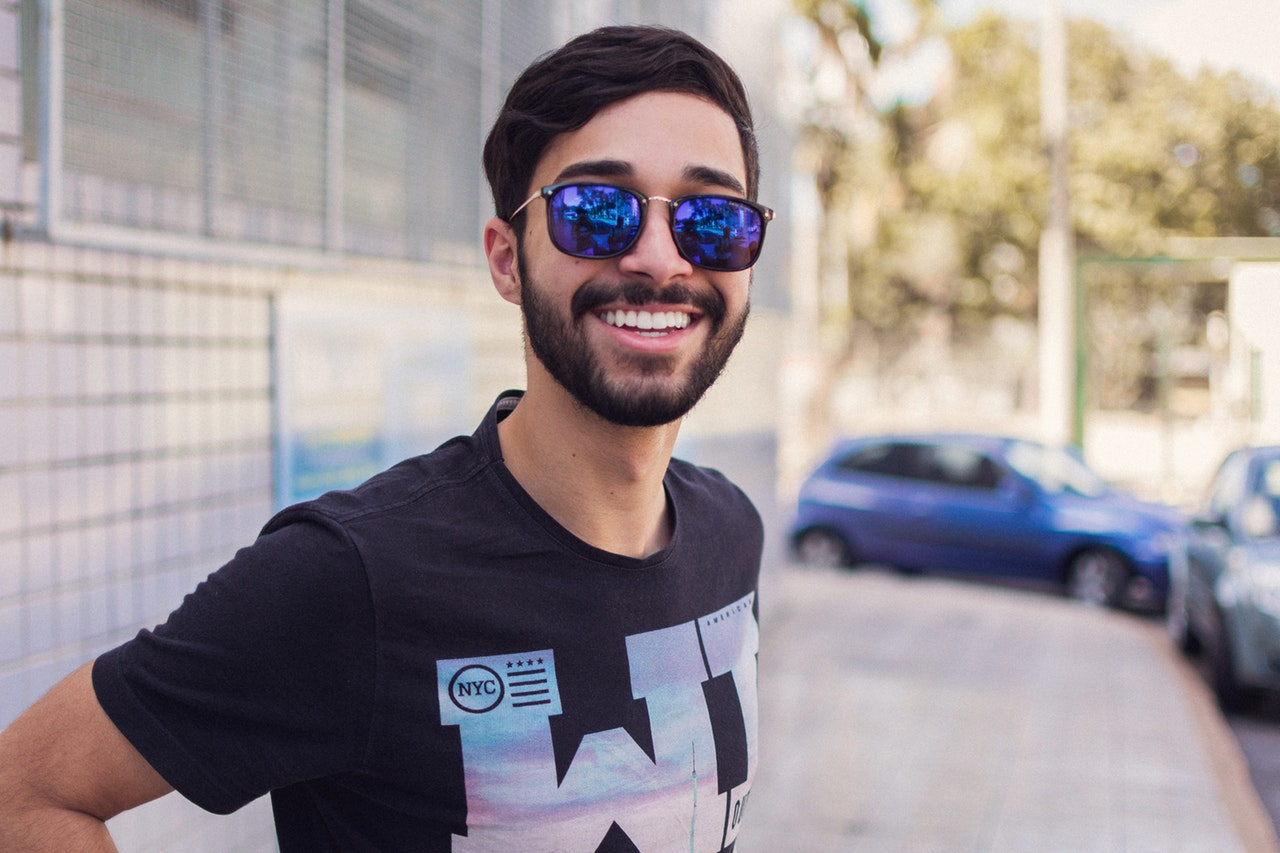man with sunglasses and white teeth