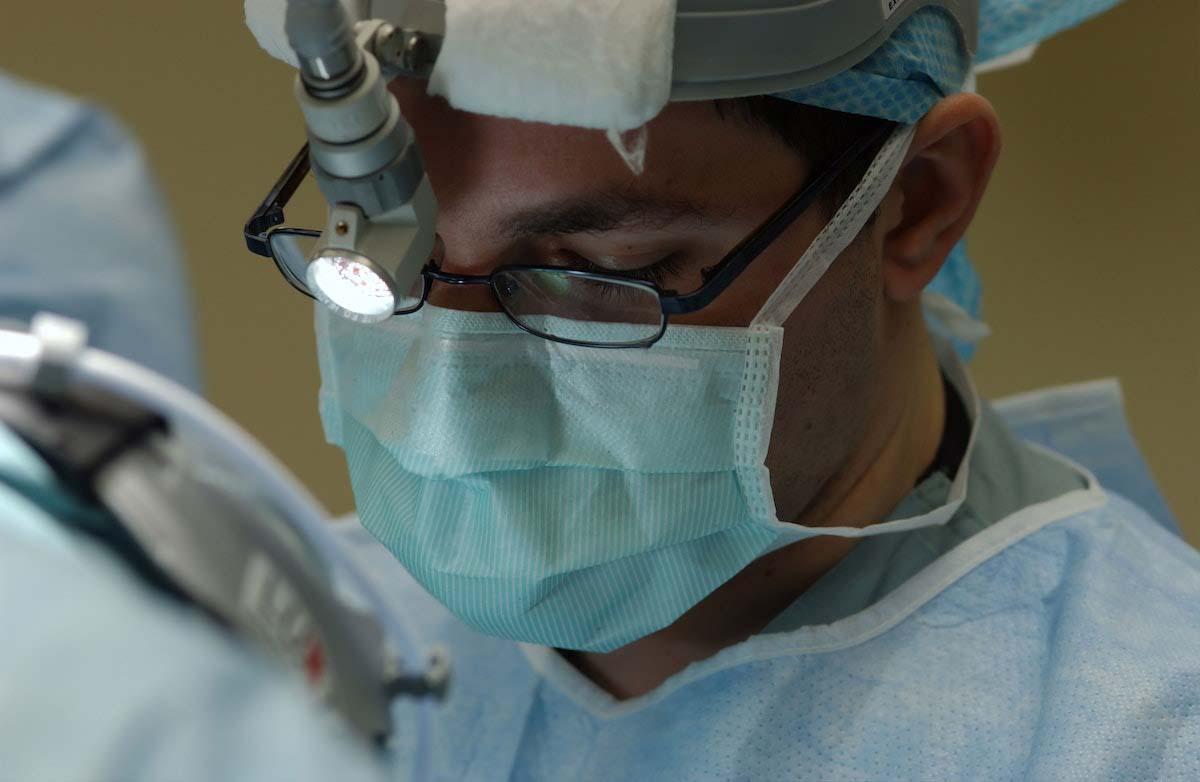 Oral surgeon performing a dental implant procedure