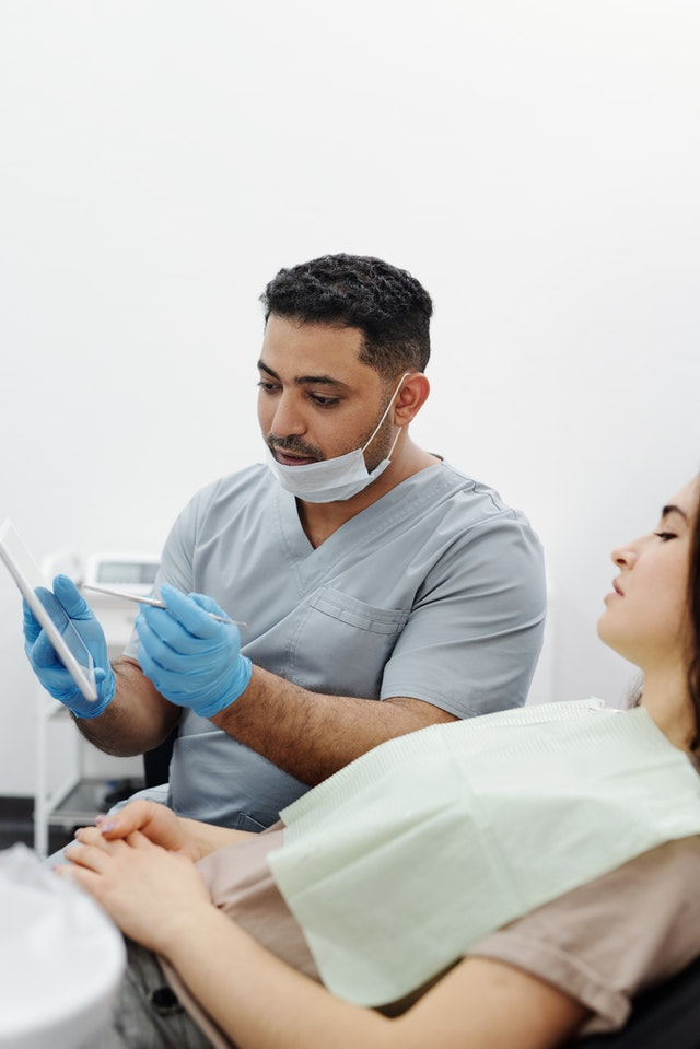 dentist reviewing procedure with patient