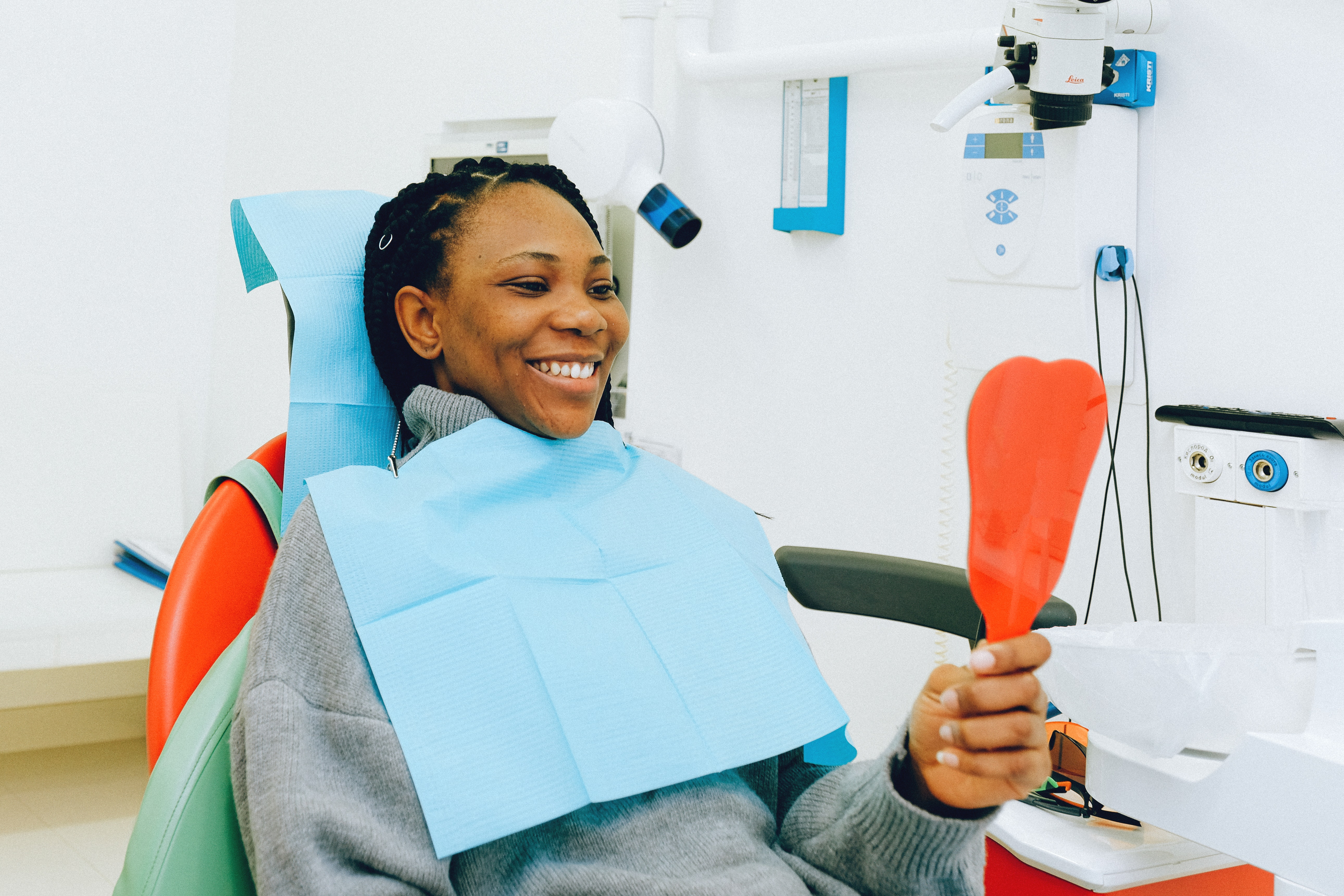 Woman admiring teeth after a dental cleaning